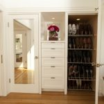 Built in drawers and shoes closet organizer a bench full length mirror with white frame wood flooring system