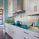Clean and pure white subway tiles backsplash made from ceramic beautiful turquoise cooking tools elegant and simple white kitchen cabinet systems white kitchen countertop