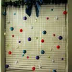 Colorful Christmas balls that are hung on window