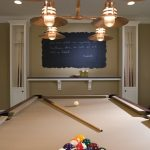 Combined basement lighting idea for basement game room with a billiard table yard chalkboard wall decoration and floating shelf for organizing some decorative items