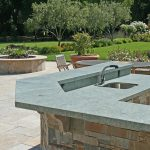 Concrete countertop for outdoor with complicated shape plus sink and faucet a set of patio furniture