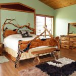 Cool rustic bed furniture rustic vanity with drawers and wood framed mirror smooth wool bedroom rug in  three different tone colors wood planks floors a mat