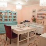 Craft room in classic style with white crafting desk and maroon work chair blue buffet furniture with transparent glass door classic pendant lamps a classic white credenza furniture a white carpet