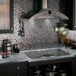 Creative backsplash tiling made from stainless steel electric stove appliance grey marble kitchen countertop
