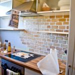 Creative rustic style kitchen backsplash design an electric stove block butcher kitchen counter white base cabinets