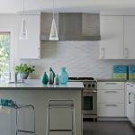 Elegant white kitchen backsplash modern gas stove white kitchen cabinet units simple and small kitchen island in white color with its barstools turquoise decorative items put on the top of kitchen island