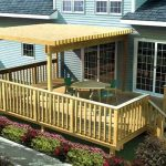 Half cover deck a pair of turquoise chairs and wood table for deck wood planks floor idea for deck vertical railing system with outdoor staircase made from wood
