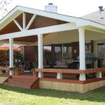 Home deck with simple horizontal rail system furniture and low outdoor staircase