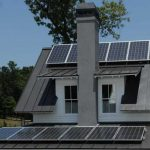 Home effective house with many solar panels as the source of natural energy