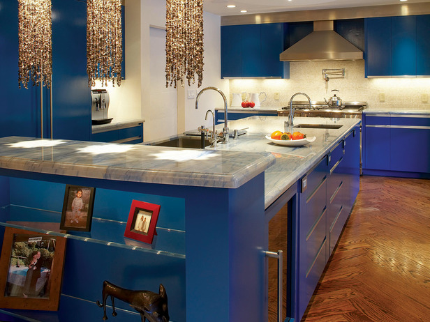 Luxurious kitchen in blue ocean theme with white marble countertop square  sink and stainless steel faucet