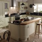 Milbourne kitchen island in curve shape with oak table bar an oak barstool  wood  dining furniture large kitchen set with black countertop and kitchen storage a pair of mason jar pendant lamps