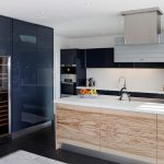 Modern kitchen idea with unfinished wood kitchen island with white counter black kitchen cabinets black ceramic tiles floors