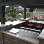 Outdoor white cement countertop that is integrated with bar a pair of bar chairs