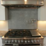 Plain concrete backsplash modern gas stove textured concrete kitchen countertops modern white cabinet systems for kitchen