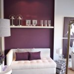 Purple and white wall paint colors single shelf single white sofa with white and purple throw pillows white side table two boxes arrangement as side table with small table lamp