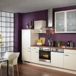 Purple wall paint color for small modern kitchen wood kitchen countertop with sink white kitchen cabinetry  a set of modern white dining furniture wood floor idea