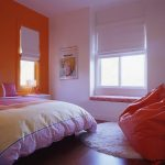 Round white wool rug for modern bedroom a large chair in orange a bench with mattress under the window loft bed furniture without headboard wood floor idea