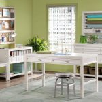 Semi classic modern room for crafting with white crafting table low leg barstool a storage unit for craft stuffs a white table with open shelf underneath a simple white painted chair light blue rug