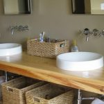 Simple bathroom vanity organization with three rattan boxes as the storage system