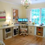Simple craft room with glass surface crafting table system for crafting tools and materials corner L shape computer desk with movable chair wood floors a pendant chandelier fixture