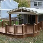 Simple deck home with cover and wood vertical railing system wood planks floor for home deck