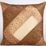 Simple throw pillow in various brown color tones with classic motifs