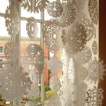 Simple white window ornaments for celebrating Christmas Day