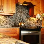 Small and black natural stones backsplash as the rustic backsplash idea for kitchen luxurious and expensive gas stove wooden kitchen cabinetry