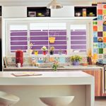 Small and colorful kitchen decorating idea with simple white kitchen island plus its modern white barstools granite kitchen countertop a pendant lamp open shelves on top