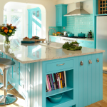 Small kitchen and kitchen bar in turquoise color with luxurious granite kitchen island top and elegant silver bar chairs  wood planks flooring system silver refrigerator