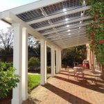 Solar panels as deck cover a set of patio furniture red bricks flooring system