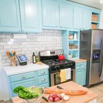 Teal upper and base cabinets for small kitchen white kitchen counter a gas stove small kitchen island with block butcher countertop cream ceramic tiles floors