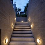 The series of modern lighting mounted on outdoor wall system near the stairase