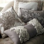 Throw pillows with textured floral motifs in their covers