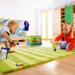 Typical area rug which is designed as miniature of football yard  for kids a closet organizer for kids' toys