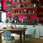 Unique  and cute kitchen decoration with bright red wall system kitchen backsplash that looks like metal  floating wooden shelves a set of dining furniture with colorful dining chair and wooden dining table