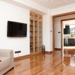 Wall Mounted TV Set Without Any TV Table Built In Shelving Units With Glass Door A Cozy Sofa