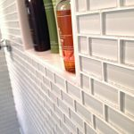 White glasss tiles for modern shower space shower wall niche for organizing shampoo and liquid bodysoap