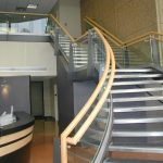 Wood handrail for modern staircase with transparent glass rails