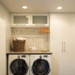 Adorable White Simple Laundry Room Idea With Smallest Stackable Washer Dryer With Backsplash And Upper Cabinet And Rattan Basket And Closet