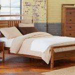 adorable wooden platform bed with white sheet aside small wooden nightstand with potted plan aside wooden chest of drawer from skandinavian furniture austin