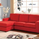 affordable red fabric sectional couches for contemporary living room ideas decorated with wall mounted shelf and white rug plus glass top coffee table