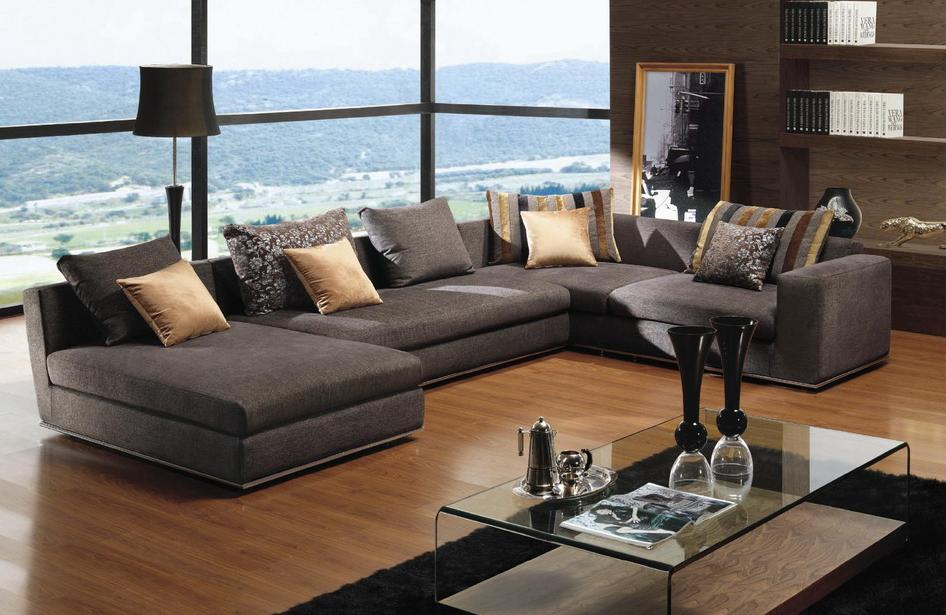 Affordable Sectional Couches In Grey With Decorative Cushion And Gl Coffe Table On Top Of Black
