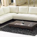 affordable white leather sectional couches for modern living room decorated with wooden coffee table and black soft rug
