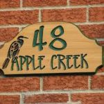 Artistic Address Plaques For Home Design With Reddish Brick Wall Design With Wooden Plaque Of Number 48 With Apple Creek Writing