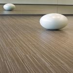 awesome washed white wooden vinyl plan flooring style with egg decoration before large mirror