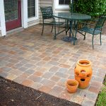 basketweave brick paver calculator for stunning patio with metal chairs and round table with umbrella aside with garden