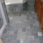 best flooring for bathroom tile in grey with wooden vanity units and granite countertop plus black knob and bathtub