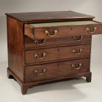 classic and vintage chest of drawer with rustic metal handles and long storage with wooden legs with carved style