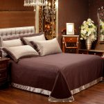 Classic Expensive Brown Bedroom Design With Classy Brown Cotton Sheet With Tufted Headboard Beneath Luxurious Chandelier Aside Wooden Nightstand